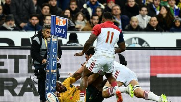 Incredible: Tevita Kuridrani scores in the corner with a brilliant piece of athleticism.