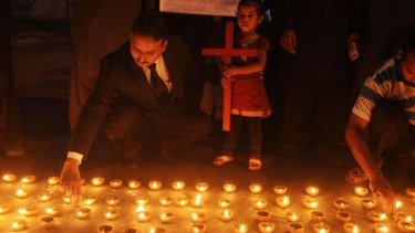 Pakistani Christians light candles during a protest in Lahore following the suicide bombing of a church in Peshawar that killed 85 Christians.