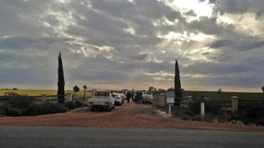 Police at the scene of the murder of three children and a woman near Wagga.