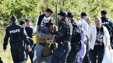 Danish police clash with one of about 300 migrants in September.
