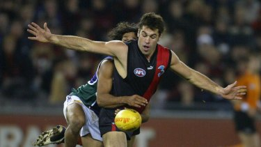 Former Essendon premiership player Dean Solomon will take over as interim coach at the Suns.