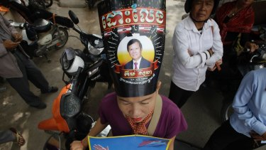 A supporter of the opposition Cambodia National Rescue Party protests in support of jailed party president Kem Sokha.