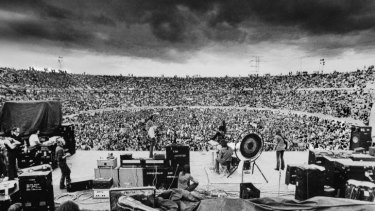 Rain song: Led Zeppelin play Kooyong Stadium in 1972 as a storm brews.