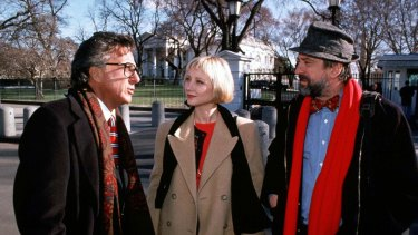 Dustin Hoffman, Anne Heche and Robert De Niro in a  scene from the Barry Levinson's Wag The Dog.