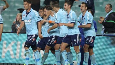 Italian job: Sydney players celebrate with Del Piero after his first-half strike.