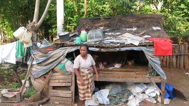 Asia, whose son Sam is in an Australian Jail, photographed outside her hut on the island of Bima.