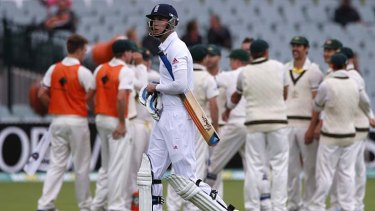 Into the gloom: England's Stuart Broad walks off the field after his disappointing dismissal.