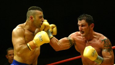 """""""An honest and simple man"""" ... Wissam Fattal, left, in a bout with Nick Kara in 2004."""
