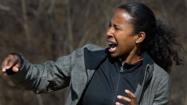 Al-Jazeera TV camera woman Trudy Hutcherson reacts as she is targeted with the new heat ray at a media demo at the US Marine Corps Base Quantico, Virginia.