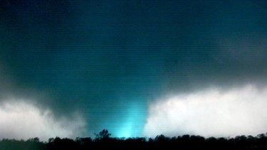 Amateur video captures lightning striking inside the twister as it bears down on Joplin, Missouri. Photo: AP/tornadovideo.net