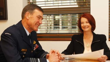 Prime Minister Julia Gillard speaks with Defence Chief Angus Houston.