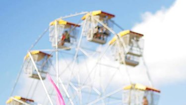 Stilt walkers entertain the crowd in front of the Ferris wheel on April 3.