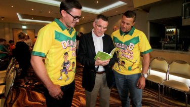 Logan deputy principal David Hartley and retired Broncos player Scott Prince with Queensland Arts Minister Ian Walker