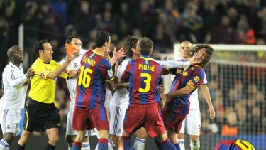 Sergio Ramos of Real Madrid pushes Carles Puyol's face before being sent off for a terrible foul on Lionel Messi.