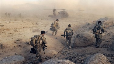 Special Operations Task Group soldiers make their way to a waiting UH-60 Blackhawk helicopter in Sha Wali Kot.