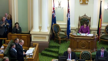 Premier Campbell Newman addresses Parliament as new speaker Fiona Simpson looks on.