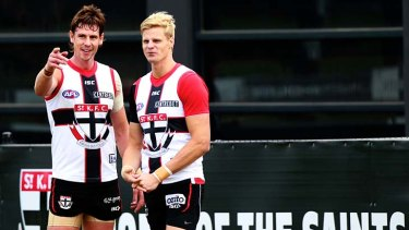 Tale of two homes: Justin Koschitzke (left) and Nick Riewoldt at a St Kilda training session at Seaford.