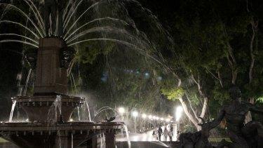 Hyde Park lights up at night.