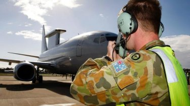 Ground crew prepare an RAAF E-7A Wedgetail Airborne Early Warning and Control aircraft.