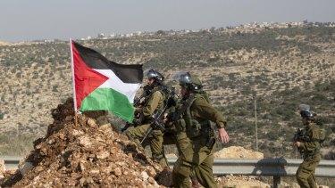 Israeli troops advance toward Palestinian demonstrators near the occupied West Bank village of Aboud, near Ramallah.