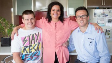 Lambie with her sons Dylan, left, and Brentyn at their home in Burnie.