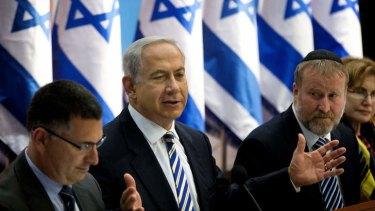 Israel's Prime Minister Benjamin Netanyahu, centre, speaks during the weekly cabinet meeting in Jerusalem.