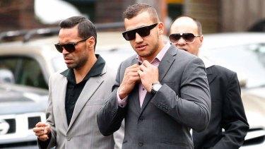 NRL player Blake Ferguson, right, arrives at court with Anthony Mundine in December.