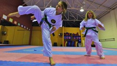 Battistello Karate students Sienna Battistello and Benni Barnet-Holmes train at the dojo in Malvern East.
