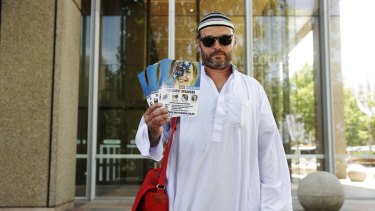 Nick Folkes leaves court dressed in mock Islamic outfit after appealing against a Federal Court injunction to stop the commemorations of the 2005 Cronulla race riots.