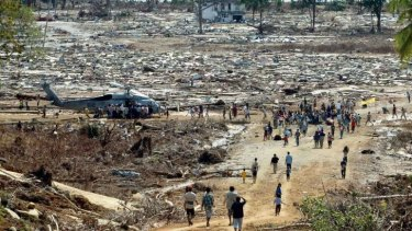 Aid effort: Indonesian tsunami survivors receive food and water from a US helicopter after the 2004 Boxing Day tsunami.