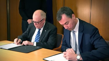 Federal justice minister Michael Keenan and ACT police minister Mick Gentleman signed the Policing Arrangement Memorandum of Understanding in Canberra on Thursday, June 15.