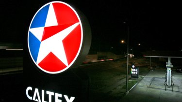 Caltex writes down value of two key refineries.