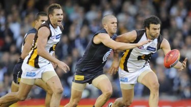 Carlton's Marc Murphy and Hawthorn's Jordan Lewis compete during their match last year.