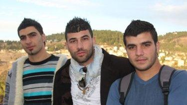 Victims ... Osama Ghanaim, right, with fellow Arab students Ahmad Abu Saleh, left, and Mahmoud Abu Saleh.