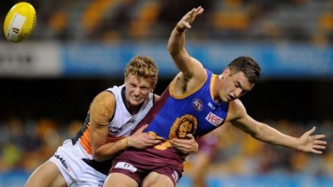 Will Hoskin-Elliott of the Giants tackles Tom Rockliff of the Lions during the round 13  match on Saturday.