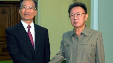 Shaking on it . . . China's Wen Jiabao with Kim Jong-Il.