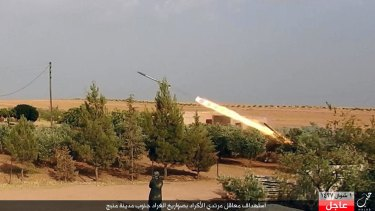 A member of Islamic State militants fires a Grad missile towards Kurdish-led forces in Manbij.