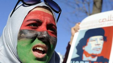 A woman with her face painted in the colours of the Libyan flag joins a demonstration against Muammar Gaddafi in front of the White House in Washington.