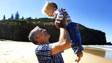 Bewildered: Newcastle dentist Andreas Schwander with his son Philip at Redhead Beach.