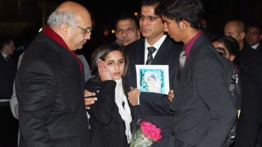 British MP Keith Vaz (left) speaks with the daughter Lisha, husband Ben Barboza and son Junal of nurse Jacinta Saldanha, as they arrive at the Houses of Parliament in London, December 2012.