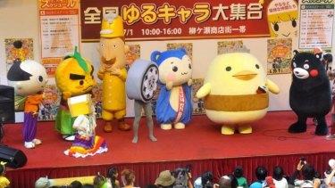 """Yuru-kyara"", or ""laid-back characters"", performing at the Yanagase shopping district in Gifu."