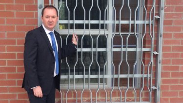 Corrective Services Minister Joe Francis unveils the new bars on windows at Banksia Hill.
