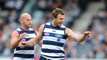 Cameron Mooney celebrates one of his goals against Melbourne with Paul Chapman.