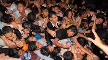 A crowd of Cambodians is pushed onto a bridge on the last day of celebrations of a water festival in Phnom Penh.