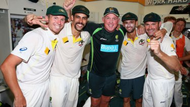Winners' circle: Peter Siddle,  Mitchell Johnson, Craig McDermott, Nathan Lyon and Ryan Harris celebrate in the dressing rooms