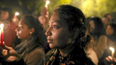 Demonstrators at a candlelight vigil for a gang rape victim who was assaulted in New Delhi on December 29, last year.