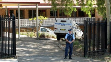 Evacuated ... police outside Hunter Christian School in Mayfield, Newcastle.