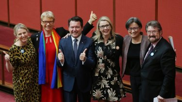 Senators Louise Pratt, Janet Rice, Dean Smith, Skye Kakoschke-Moore, Penny Wong and Derryn Hinch celebrate the passing of the marriage equality bill in the Senate.