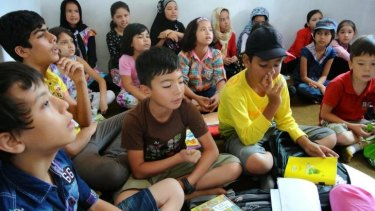 A class at the learning centre in Cisarua.