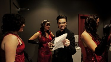 Rocco d'Amore surrounded by burlesque dancers at The Croxton Hotel in Thornbury.